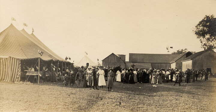 Photograph of fair or circus tents with crowd